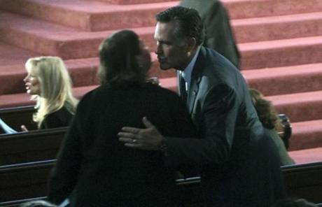 Former Massachusetts governors Jane Swift (left) and Mitt Romney in the Cathedral of the Holy Cross.