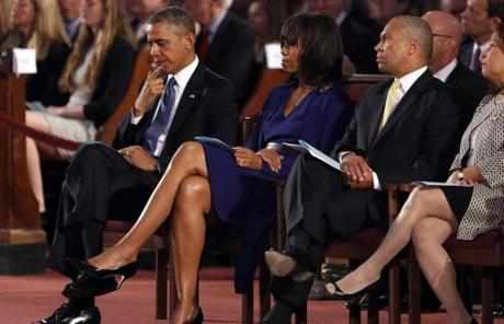President Obama sat in the Cathedral of the Holy Cross with Michelle Obama and Governor Patrick.