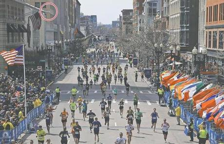 A surveillance camera atop Lord & Taylor (circled) took images across Boylston Street of the area where the second bomb exploded Monday.