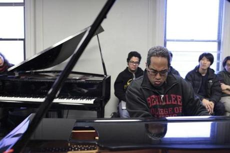 Perez playing in his Berklee classroom.