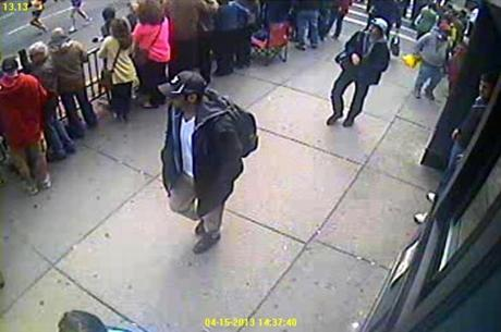 The FBI Thursday released photos and video of two suspects in the deadly Boston Marathon bombings, appealing to the public to help find them.