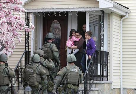 SWAT teams conducted a house to house search in  Watertown.