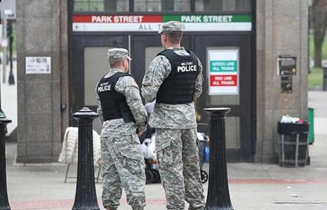 Military Police stood at the Park Street T Station as the city was locked down during the manhunt for the marathon bombing suspect.