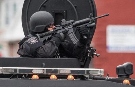 SWAT teams moved into position in Watertown Friday morning during a massive manhunt for one of the Marathon bombing suspects.