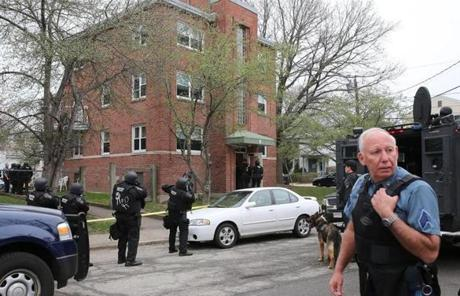 Police searched a building in Watertown.
