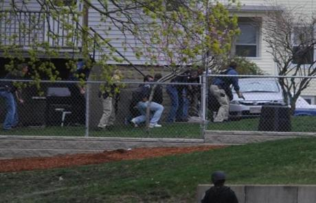 Officers approached an area in Watertown where the second bombing suspect was hiding.