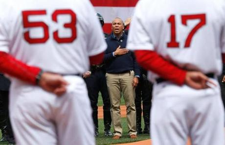 Governor Deval Patrick was on the field with other officials and guests.