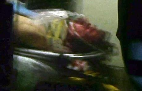 A still frame from video shows Dzhokhar A. Tsarnaev visible through an ambulance window.