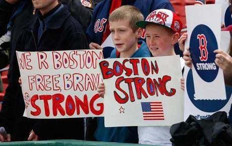 Fans held signs at Fenway park on Saturday.