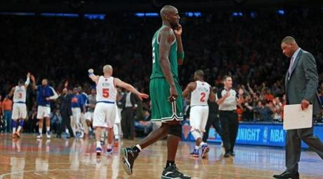 4/20/13: New York, NY: Knicks are celebrating everywhere, but the Celtics Kevin Garnett (center) and head coach Doc Rivers (far right) are not, as Boston is forced to take a timeout in the fourth quarter after a Knicks score, as New York was pulling away for the victory. The Boston Celtics visited the New York Knicks in Game One of an NBA Eastern Conference Quarterfinal Playoff game at Madison Square Garden. (Jim Davis/Globe Staff) section:sports topic:Celtics-Knicks (1)