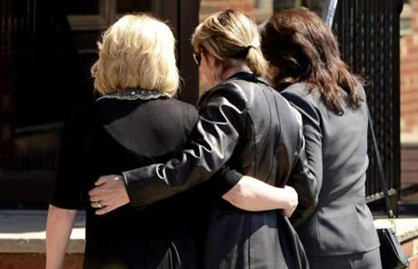 Unidentified mourners, arm-in-arm, entered the wake for Krystle Campbell, a bombing victim, in Medford on Sunday.