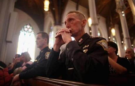 Boston Police Superintendents William Evans, right, and Kevin Buckley attended Mass at the Cathedral of the Holy Cross.