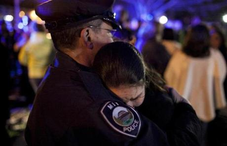 A woman hugged an MIT police officer after a vigil in Wilmington for slain officer Sean Collier.