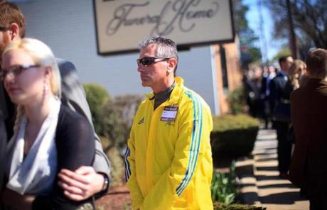 John Dalone of Stoneham, a BAA volunteer, came to pay his respects to bombing victim Krystle Campbell.