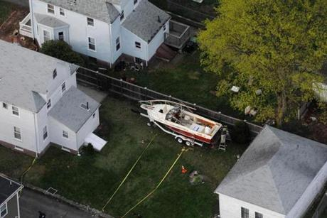 Investigators worked on Saturday around the boat where Marathon bombing suspect Dzhokhar Tsarnaev was found hiding afteramassive manhunt.
