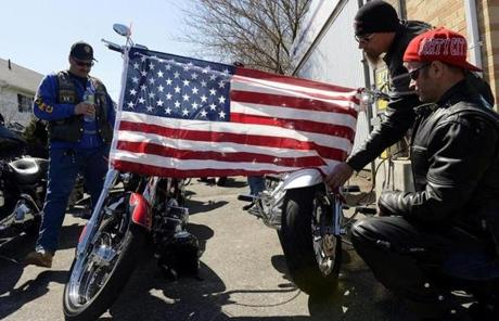 Unidentified men placed an American flag on their motorcycles outside the wake for Krystle Campbell.