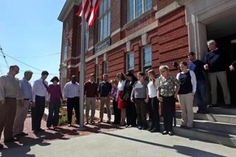 Outside of Hopkinton's Town Hall, employees gathered for a moment of silence.