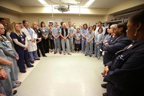 Staff at Beth Israel Deaconess Medical Center gathered inside a Trauma Room to observe a moment of silence.