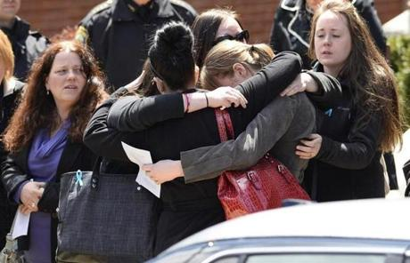 Mourners gathered to console each other outside of the church.