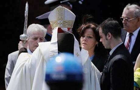Cardinal Sean O'Malley, with scepter, helped officiate the funeral Mass, and met with Campbell's mother after.