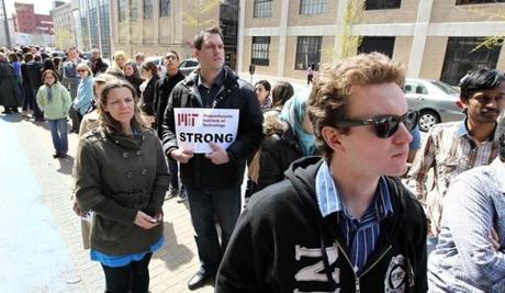 MIT students and staff gathered along Vassar Street in Cambridge for a moment of silence.
