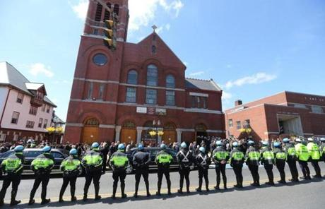 Police lined the street as family, friends and mourners arrived at Krystle Campbell's funeral.