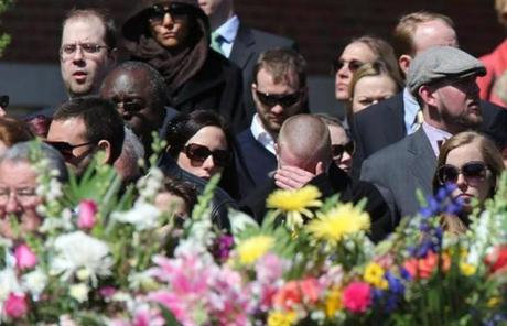 Mourners outside the funeral in Medford.