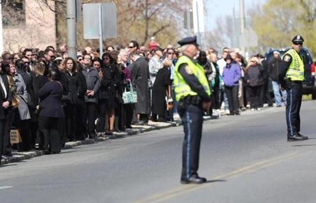 Hundreds lined the streets near the site of the funeral.