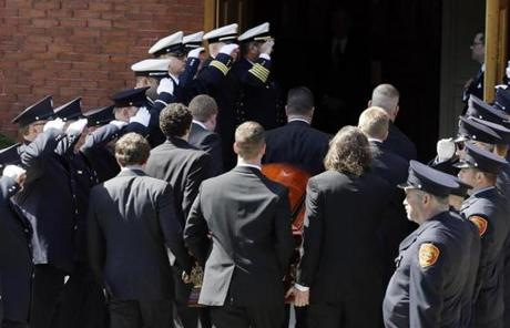 An honor guard from area fire departments saluted as the casket of Marathon bombing victim Krystle Campbell was carried into St. Joseph's Church in Medford.