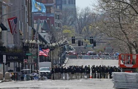 FBI and other officials at the site of one of the explosions on Boylston Street observed a moment of silence.