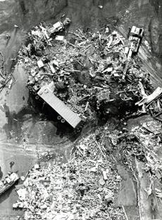 August 28, 1973: An overturned tractor-trailer rig lay amidst the ruin of the Berkshire Truck Plaza in West Stockbridge after being hit by the tornado.