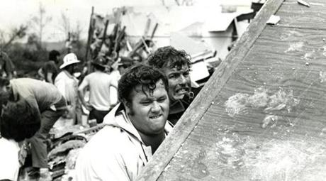 August 28, 1973: Volunteers in West Stockbridge lift debris in search of bodies after a powerful tornado stuck the area. Four people were killed and 35 injured. The estimated wind velocity at the core of the tornado was 250 mph.