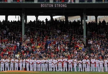 """Boston Strong,"" shown by the Red Sox on the video board, has become a popular motto for local athletes."