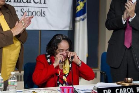 Carol R. Johnson wiped away tears after announcing her plans to retire at a School Committee meeting Wednesday.