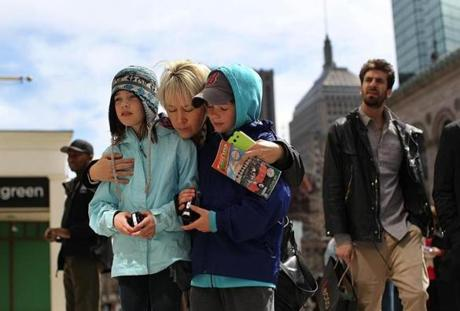 Boston, MA., 04/24/13, Boylston Street is now open to the public. Tanya McIntyre brought her twins Tiana and Colten, 9, down to the site of the first bombing and said a prayer.