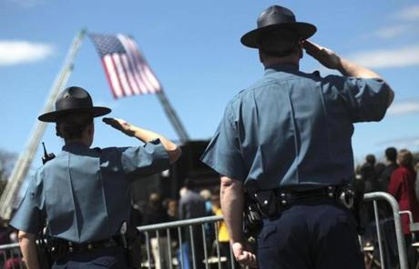 Massachusetts State Police officers saluted during the memorial service for MIT Police Officer Sean Collier.