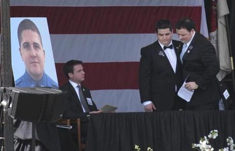 Andrew Collier's brothers spoke at the memorial service.