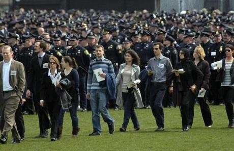 Mourners arrived for the service in front of thousands of police officers.