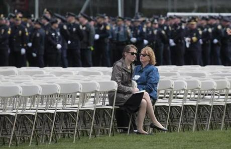 Police filed into the memorial service for MIT Police Officer Sean Collier at Briggs Field on the MIT campus.