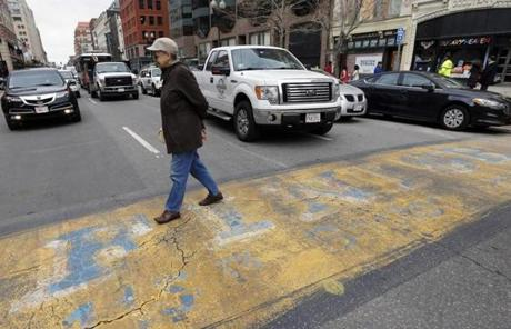 Traffic moved down Boylston Street past the Boston Marathon finish line on Wednesday.