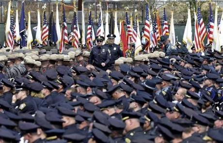 Police officers arrived by the thousands to a memorial service for Collier.