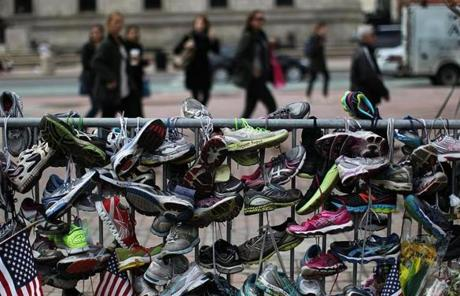 Running shoes were hung from a fence at the site of the Copley Square memorial.