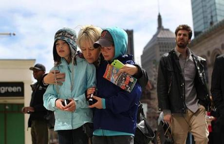 Tanya McIntyre brought her nine-year-old twins, Tiana and Colten, to the site of the first bombing and said a prayer.