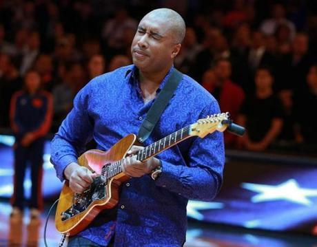 Former Yankees outfielder Bernie Williams performed the national anthem on his guitar before the game.