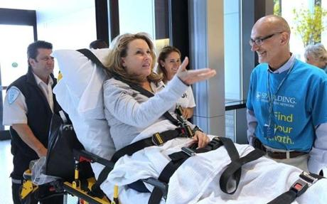 Boston Marathon bombing victim and patient Roseann Sdoia commented on the artwork in the new lobby as she was greeted by David E. Storto, president of Partners Continuing Care & Spaulding Rehabilitation Network.