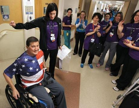 Randy Clukey of Carrabassett Valley, Maine, was applauded before he left the old location of the Spaulding Rehabilitation Hospital Boston.