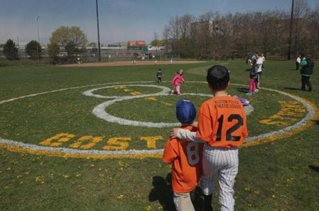 Dorchester, MA 042713 Brothers Andrew and James O'Connell visited a logo honoring Martin Richard (cq) during opening day of Little League play in Savin Hill, Saturday, April 27 2013. Richard (cq) was a member of the Savin Hill Rangers. (Staff Photo/Wendy Maeda) section: Metro slug: 28bombjane reporter: David Abel