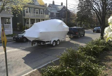 The boat where bombing suspect Dzhokhar Tsarnaev was found hiding last week was removed Friday from a yard on Franklin Street in Watertown by a team of federal investigators.