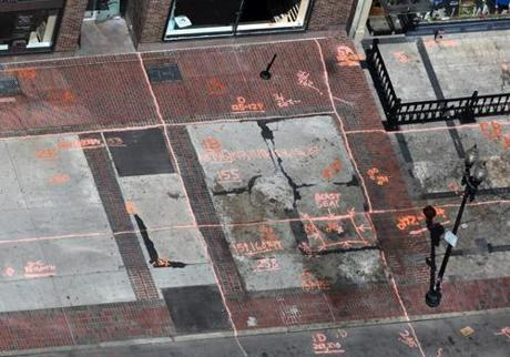 Investigators mapped a grid and marked pieces of evidence at the site of the first blast.