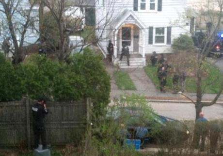 SWAT teams prepared to raid the Franklin Street yard where the suspect was believed to be hiding in a boat.